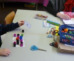 Children playing sight word bingo.