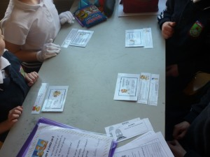 Children place their role cards and cue cards in front of them.